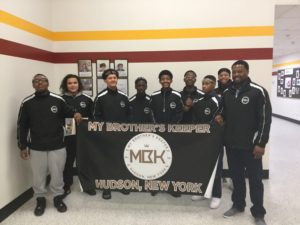 my brother's keeper boys holding MBK banner