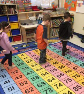 kindergarten children on a number rug
