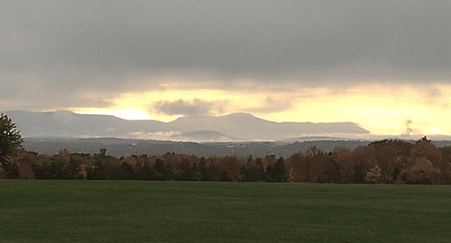 field and mountains behind Hudson High School