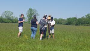 students examining a birdhouse