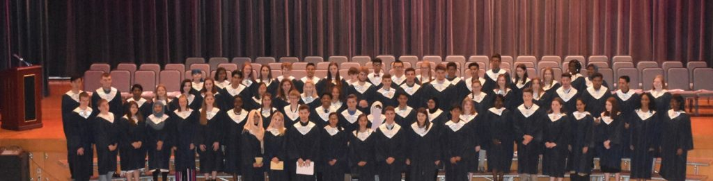 2019 National Honor Society members and new inductees on auditorium stage