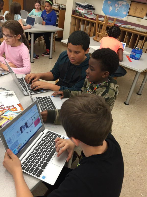 elementary students using Chromebooks