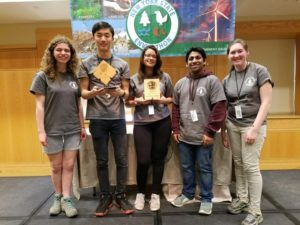 Envirothon team holds plaque