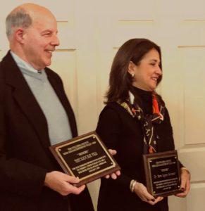 Dr. Maria Lagana Suttmeier hold award plaque next to another award recipient