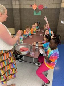 Ms. Ruud helps children make meatballs