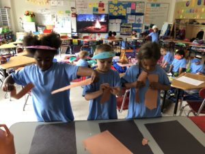 elementary students make camp fire from construction paper