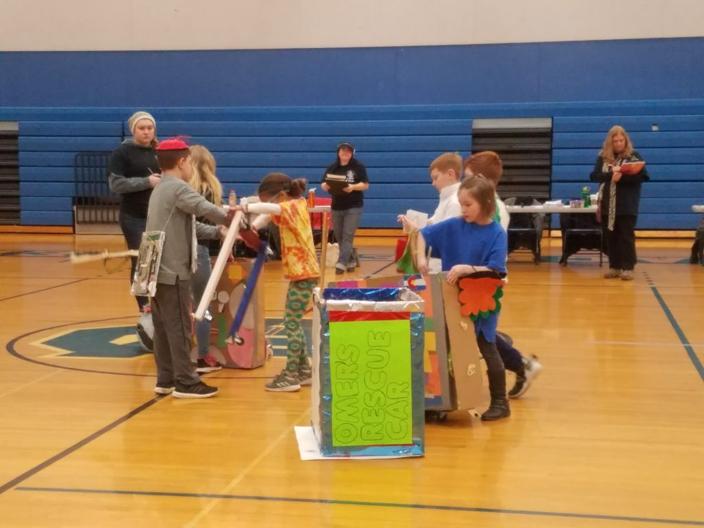 Odyssey of the Mind students during their compeition performance