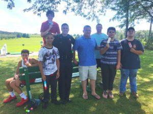 Deputy Sohotra with Principal Reardon and boys outside