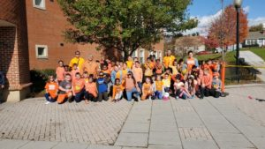 staff and students wearing orange t-shirts