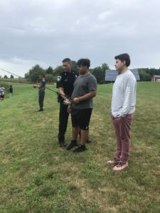 Deputy Sohotra shows students how to fish