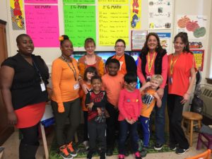 teachers and students wearing orange
