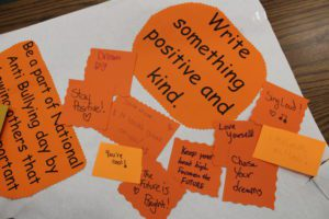positive notes on orange paper