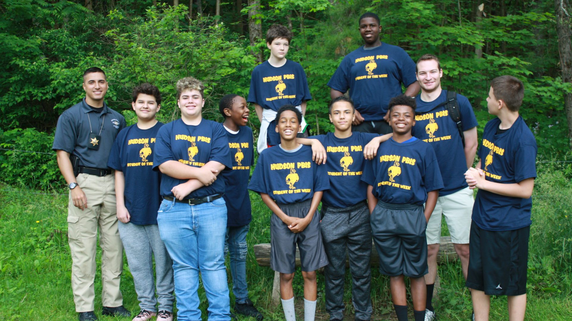 boys outside in Hudson t-shirts with Deputy Sohotra and Mr. Giosa