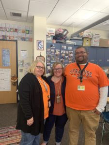 school staff wearing orange t-shirts