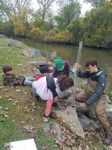children examining water sample