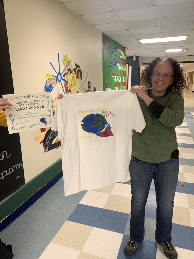 Ms. Albino holds t-shirt