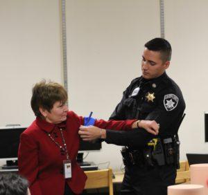 Deputy demonstrating proper use of tourniquet