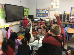 April Prestipno reads to elementary students