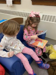two pre-kindergarten girls read together