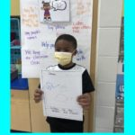 elementary students show drawing of how they show respect