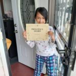 elementary student receives with a certificate