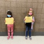 elementary students holding Honesty/Trustworthiness Certificate