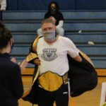principal removes his boxing robe