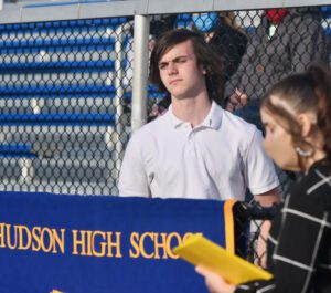 male student at outdoor podium
