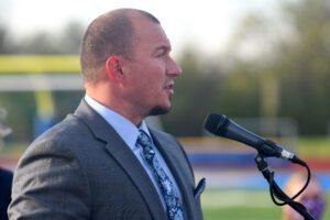 male speaks at outdoor podium