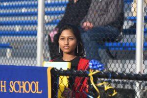 female student at outdoor podium
