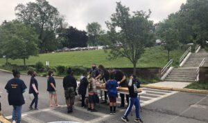 students lined up outside to receive donuts