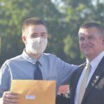 Principal Reardon and 8th grade graduate