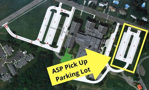 arrow and box showing where to park in the back upper parking lot